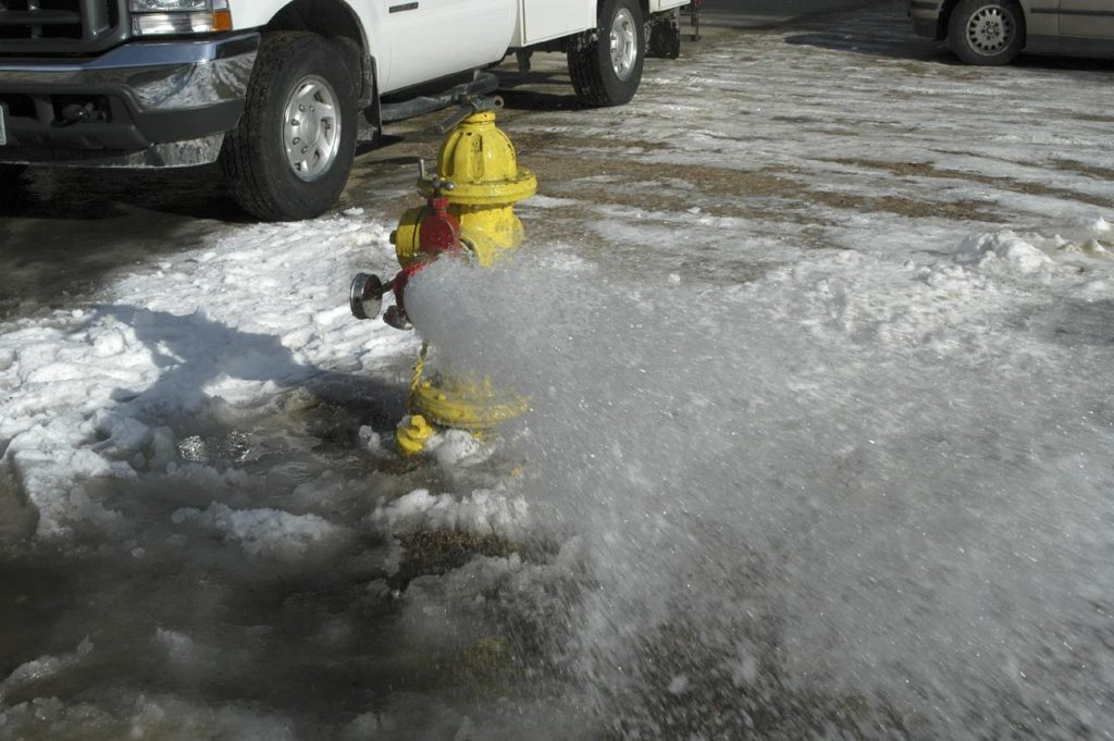 Water flowing from a hydrant