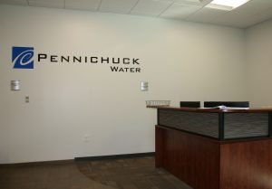 Pennichuck Water Logo and Desk